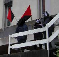 Picture of three people in badger masks